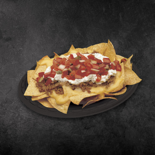 A plate of TacoTime Nachos Deluxe on a dark background